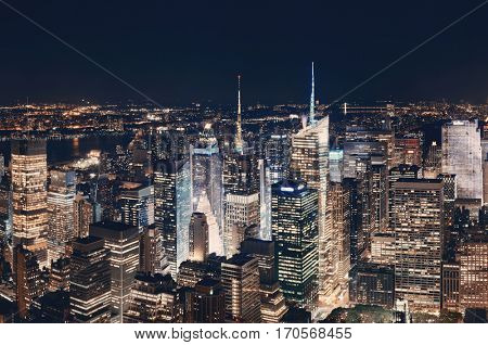 New York City midtown skyline with skyscrapers and urban cityscape at night.