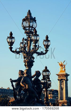 Vintage lamp post on Alexandre III bridge in Paris, France.