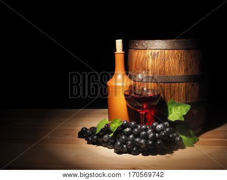 Glass Of Red Wine And Barrel On Wooden Table