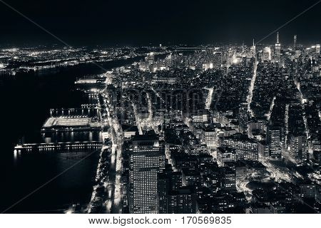 Rooftop night view of New York City midtown and Hudson River with urban skyscrapers