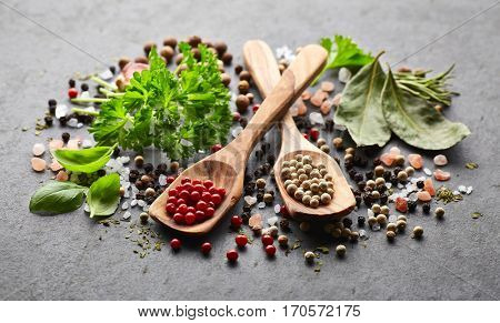 Spices and herbs on a black board