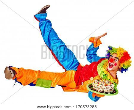 Birthday child clown with cake lying on floor and thumb up on isolated. Kid holiday sweet food celebratory in hands of events organizer man.