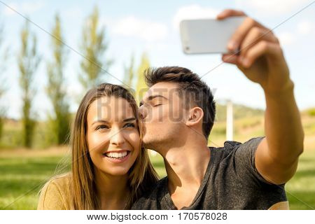 Young beautiful couple making a selfie