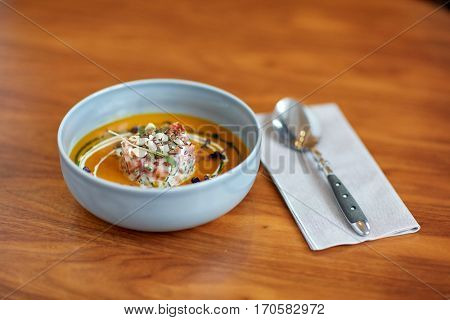 food, new nordic cuisine, dinner, culinary and cooking concept - close up of vegetable soup in bowl