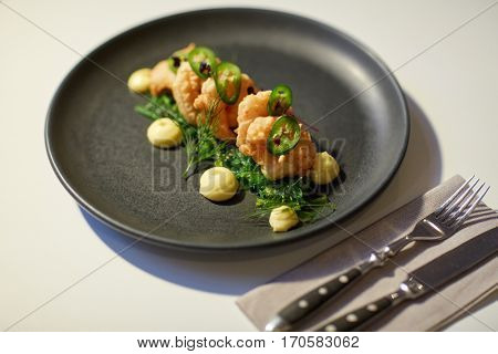 food, new nordic cuisine, culinary and cooking concept - close up of king prawns with jalapeno, wasabi mayonnaise and wakame salad on plate