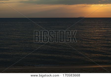 Sunset over the sea colored water in a golden color. That's very beautiful