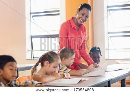 Teacher posing with her students at school