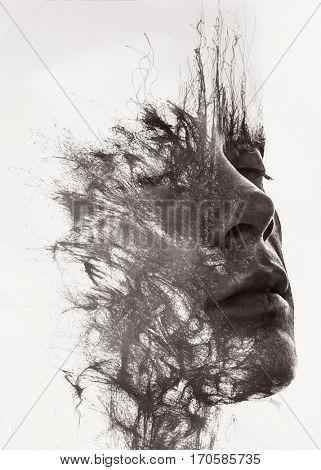 An attractive man's face dissolving into pen lines