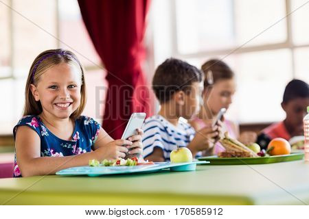 Children using technology during lunch at school