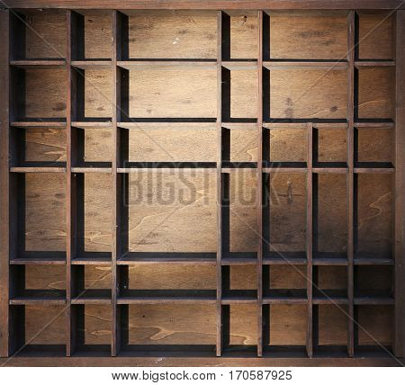 a miniature wooden shelf with dust and cobwebs in dramatic light