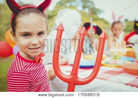 Adorable girl wearing a costume during a birthday party the park