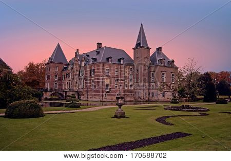 Late medieval castle 'Twickel' near Delden in the Netherlands at sunset