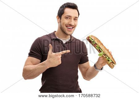 Young man holding a sandwich and pointing isolated on white background