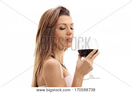 Young woman holding a glass of wine isolated on white background