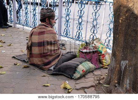 KOLKATA, INDIA - FEBRUARY 08: Homeless family living on the streets of Kolkata, India on February 08, 2016.