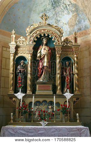 KRATECKO, CROATIA - JULY 16: Sacred Heart of Jesus altar in Parish Church of Saint Roch in Kratecko, Croatia on July 16, 2010.