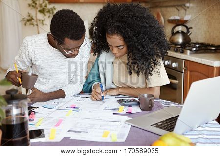 Young African Family Having Debt Problems, Not Able To Pay For Gas And Electricity, Managing Finance