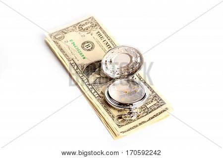 fine antique pocket watch in silver body and a small heap of paper dollars