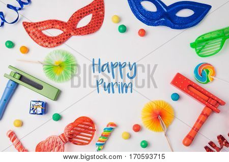 Jewish carnival Purim celebration concept on white background. Top view from above.
