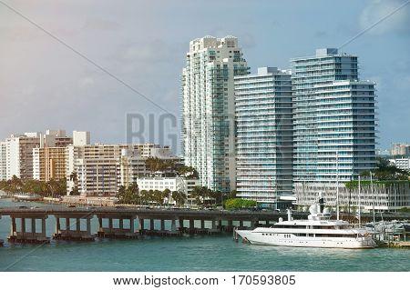 Port in downtown of Miami in skyscraper background. Skyline of Miami in Florida