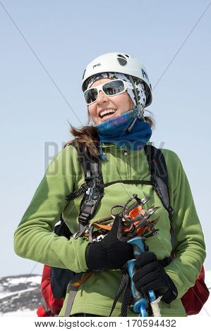 AVACHINSKY VOLCANO KAMCHATKA PENINSULA RUSSIA - APRIL 21 2012: Portrait of smiling young woman equipped ski mountaineer - participating in Open Cup of Russia on Ski Mountaineering on Kamchatka.