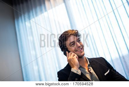 Businessman on the phone and smiling
