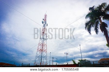 A telecommunication tower with cloudy sky as background photo taken in Bogor Indonesia java
