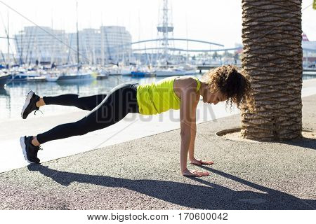Fit girl working out in Barcelona port