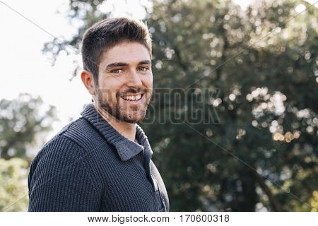 Spainsh man smiling while hiking in nature