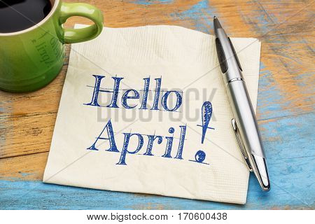Hello April - handwriting on a napkin with a cup of coffee