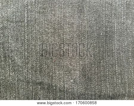 Gray jeans denim fabric texture and background.