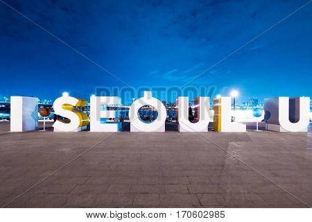 famous riverbank square with I SEOUL U in seoul at twilight