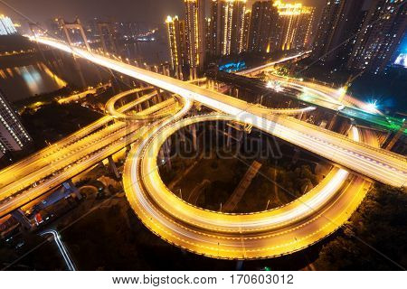 road junction and bridge in modern city at night
