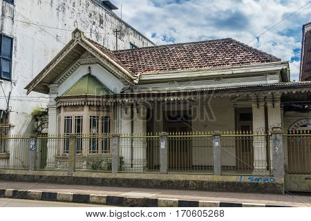 An old house building next to main street with beautiful cloudy sky as background photo taken in Bogor Indonesia java