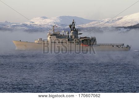 battleship sailing fog sea background snowy mountains