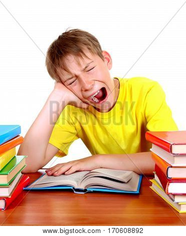 Tired Kid Yawn at the School Desk with a Books on the White Background