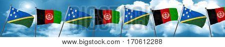 Solomon islands flag with afghanistan flag, 3D rendering