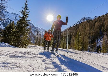 A couple of cross country skiers on a sunny winter morning in Italy Alps, South Tirol, Solda.