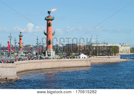 SAINT PETERSBURG, RUSSIA - MAY 09, 2015: View of the Arrow of Vasilevsky island and Rostral columns burning. Victory day in St. Petersburg