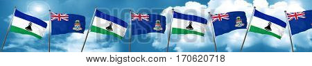Lesotho flag with Cayman islands flag, 3D rendering