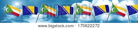 Comoros flag with Bosnia and Herzegovina flag, 3D rendering