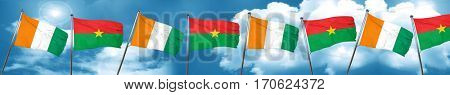 Ivory coast flag with Burkina Faso flag, 3D rendering