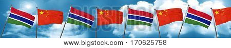 Gambia flag with China flag, 3D rendering
