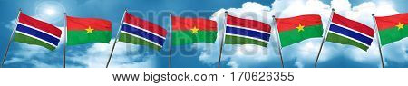 Gambia flag with Burkina Faso flag, 3D rendering