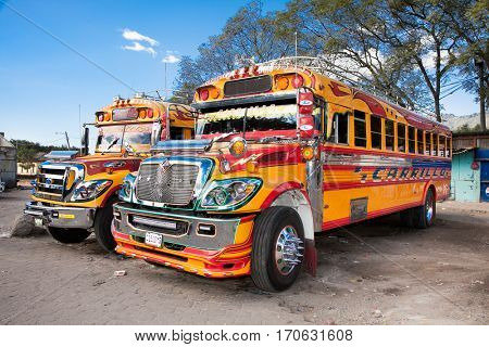 ANTIGUA,GUATEMALA -DEC 25, 2015: Typical guatemalan chicken bus in Antigua, Guatemala on Dec, 2015. Chicken bus It's a name for colorful, modified and decorated bus in various latin American countries