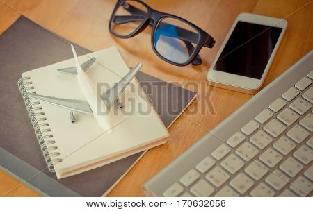 Travel blogger diary writting accessories equipment on wooden desk