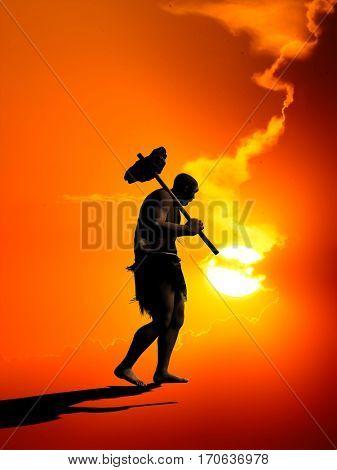 Primitive man silhouette against the sun.,3d render