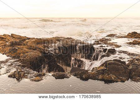Ocean beach waves at Thor's Well in Cape Perpetua Oregon Coast USA.