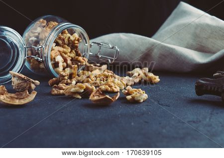 Walnuts In A Jar On A Dark Background