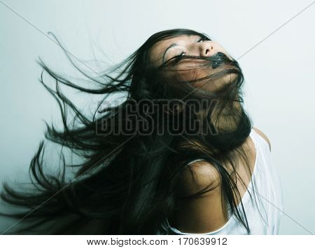 Fashion portrait of asian girl with hair lightly fluttering in the wind